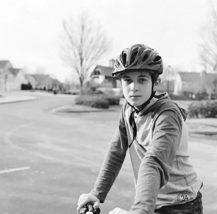 Preston Young - Son on Bike B&W