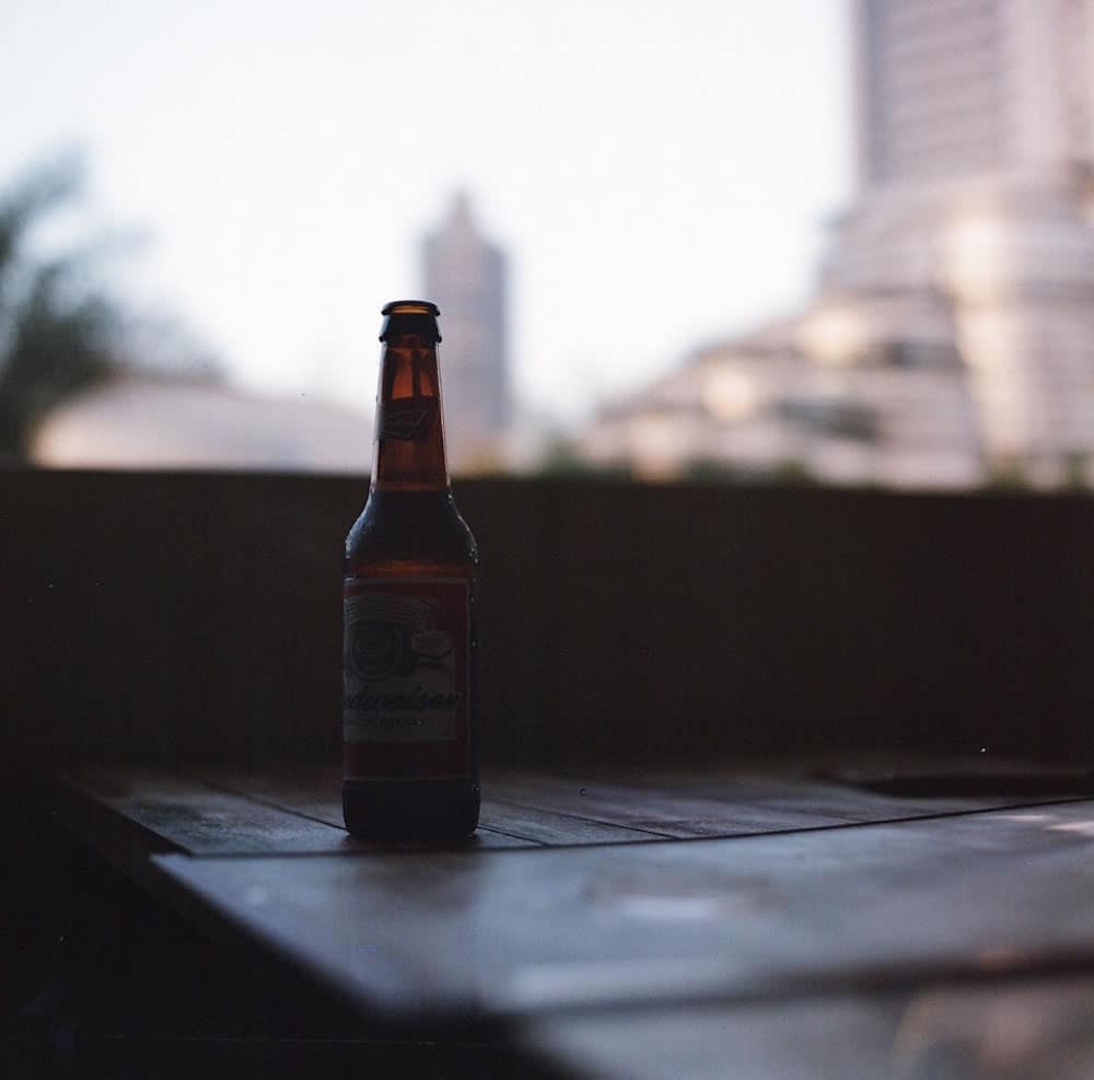 """Bottle on Table"" Claw Grill, Dubai, April 2015 - Hasselblad 500CM/ 80mm Zeiss Planar / Lomography Colour Negative 400"