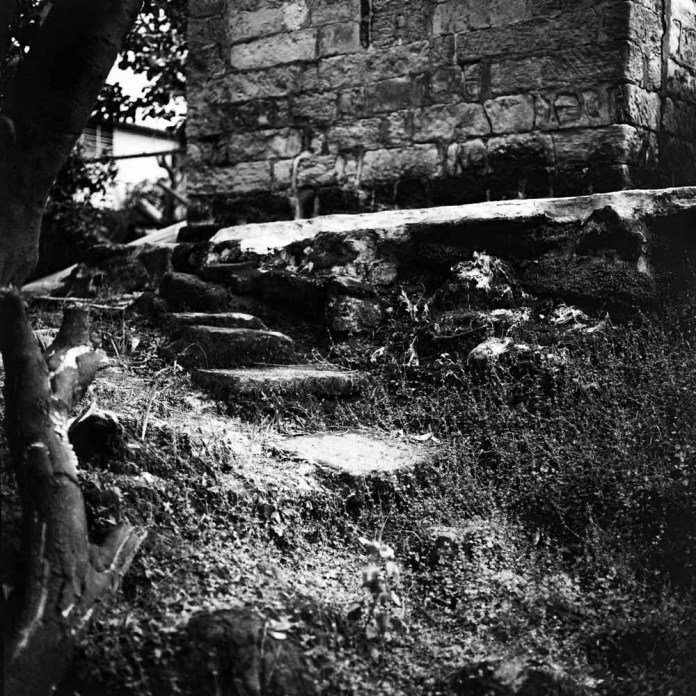 Stagnant staircase - Ilford Pan F+ shot at EI 800. Black and white negative film in 120 format shot as 6x6. Push processed 4 stops.