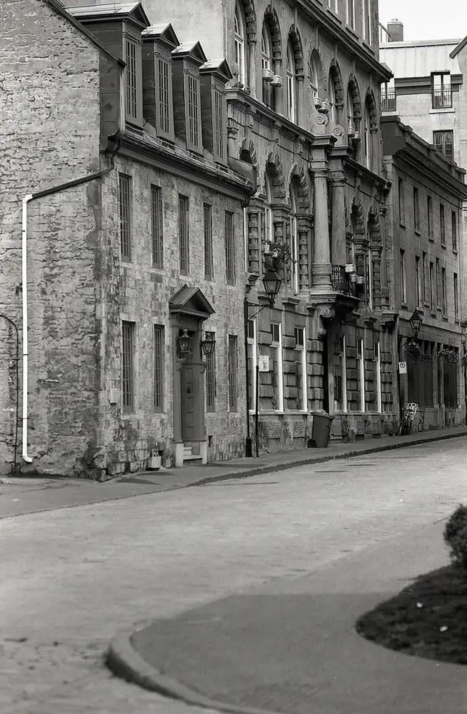 A narrow street in Old Montreal, Quebec. Nikon F4 – AF DC-Nikkor 105mm 1:2D – Ilford Delta 100.