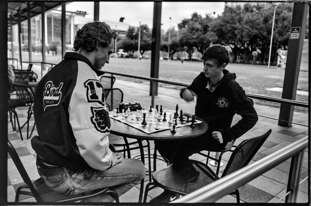 Put Some Rest On Your Chess (Houston, Texas) - Canon FTQL - Canon FD 28mm F/2.8, Ilford FP4 Plus