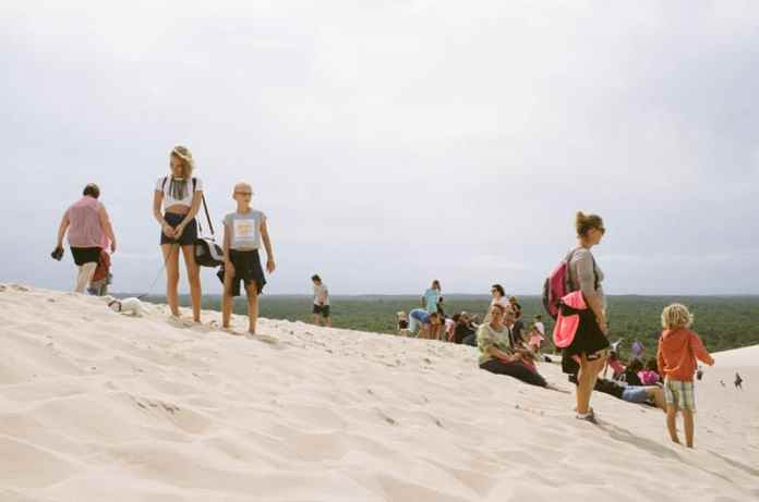 Want people? Here's a girl walking her ferret on Dune du Pilat, Arcachon