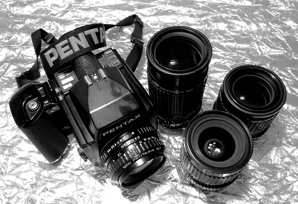 My current Pentax 645 system – Camera with 75mm, 200mm, 45mm, and 150mm (left to right)