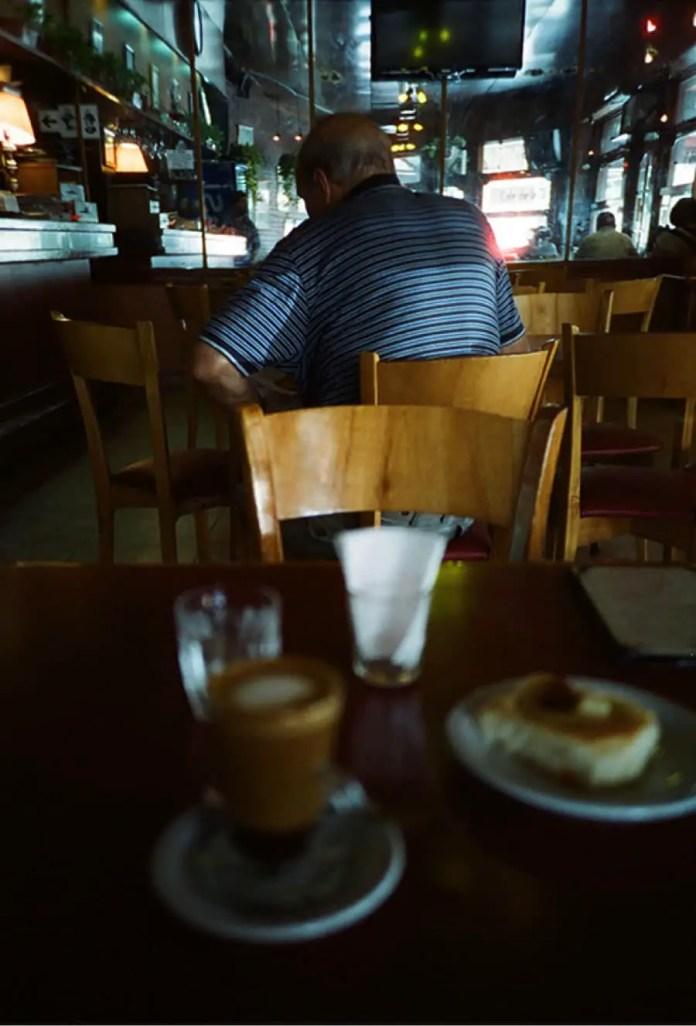Cinestill 800T shot with a Lomo LCA+ in a Buenos Aires café.