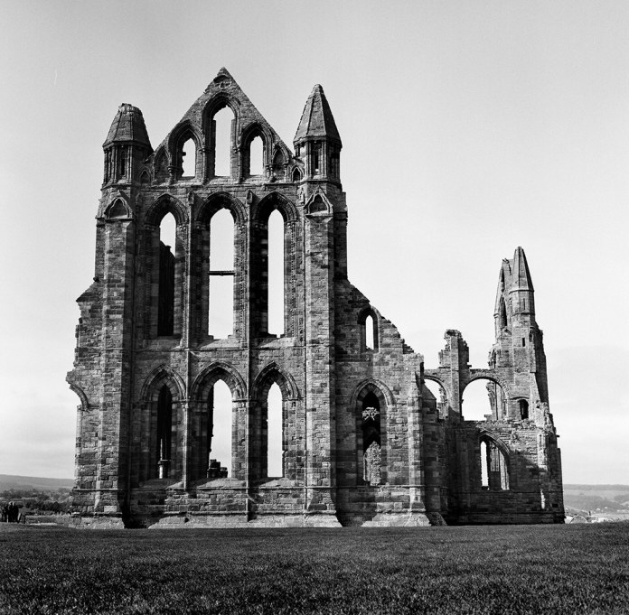 Whitby Abbey, Rolleiflex, ILFORD FP4+ - Visiting Whitby was not in my itinerary when I was travelling through the UK. But after a tipsy conversation with a bartender and a 15 minute crash course by a local on how to take the 2hr journey to this little village that inspired Bram Stoker's Dracula... I just had to go visit. And I'm glad I did. Also... in my exciting to take this shot, I left my rolleiflex lens cap lying on the marsh.... it took 30 minutes for me to trace back my steps and find the damn thing.