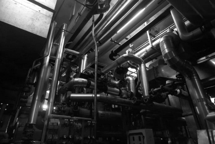 """The LRF is a 50/50% mixture of pipes and walls. All pipes are in stainless steel to avoid bacterial contamination of the fluids for film manufacturing. The core of this """"organism"""" is the """"engine room"""" located at the ground floor of the building, a quite exact cube of 40m per side. - FILM FERRANIA P30, June 2017"""