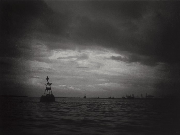 """""""Untitled"""", Malacca Strait. Fuji GS645S, 60mm f/4.0, loaded with ILFORD Pan F+ exposed at EI 50, developed in Adox Rodinal 1:50. The porthole was dirty, which created this kind of vignetting and slight distortions in the image."""