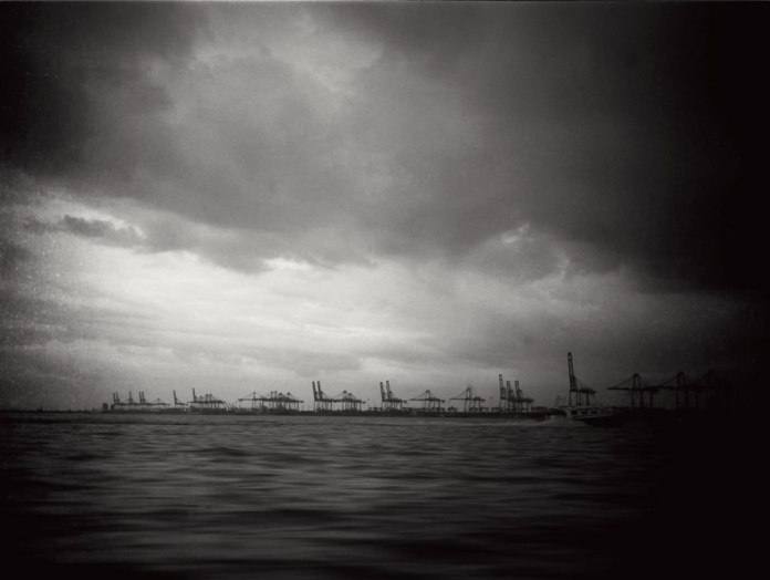 """""""Untitled"""", Malacca Strait. Fuji GS645S, 60mm f/4.0 loaded with ILFORD Pan F+ exposed at EI 50, developed in Adox Rodinal 1:50. Speeding towards Port Klang a storm was brewing. Thunderstorms are quite frequent here."""