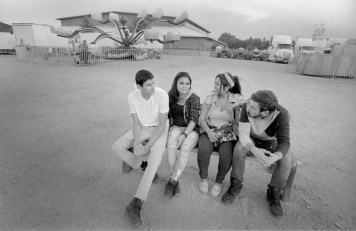 Teenagers chat on a bench at the Boulder County Fair, Longmont Colorado, July 2017 (Nikon F100, 20mm, ILFORD HP5 Plus) - Kenneth Wajda Photographer