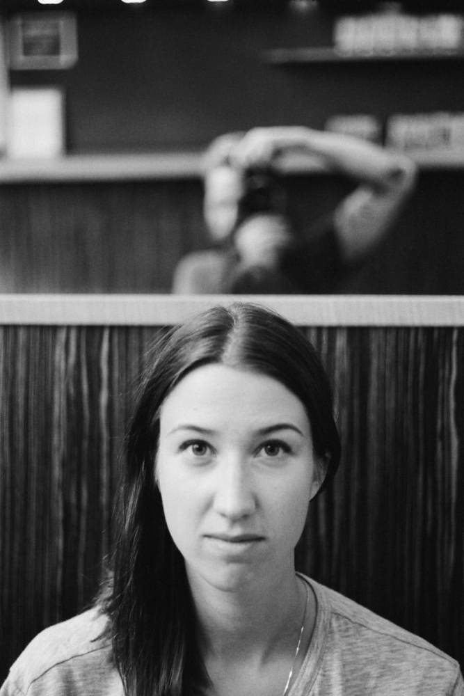 Self portrait taken with a Leica M6 on Kodak Tri-X 400 in a diner in New York City, United States.