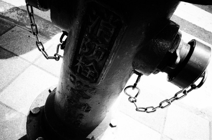 Chained - Shot on Fuji Neopan SS at EI 100. Black and white negative film in 35mm format.