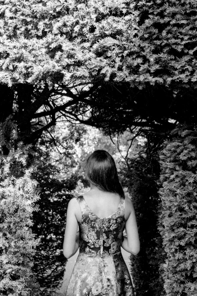 Alexis in Shrubs - Nikon FA, Nikon 50mm f/1.4,ILFORD HP5 PLUS