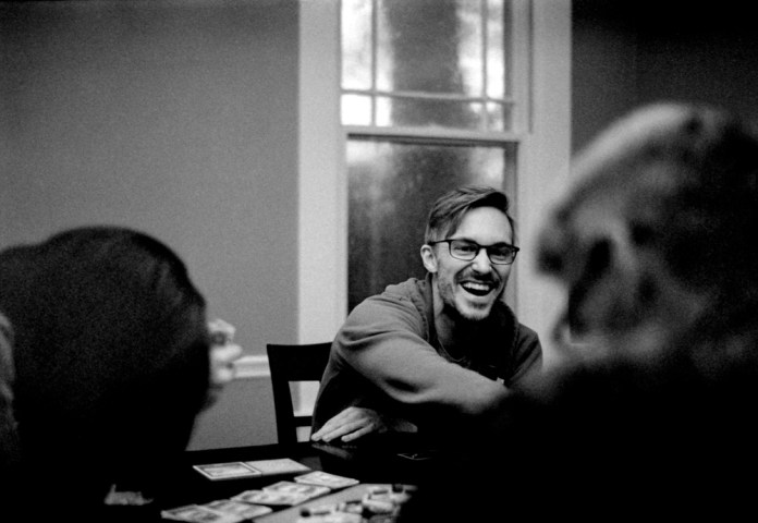 Playing Catan at My Brother's House - Nikon F3, Nikon 50mm f/1.4, ILFORD HP5 PLUS