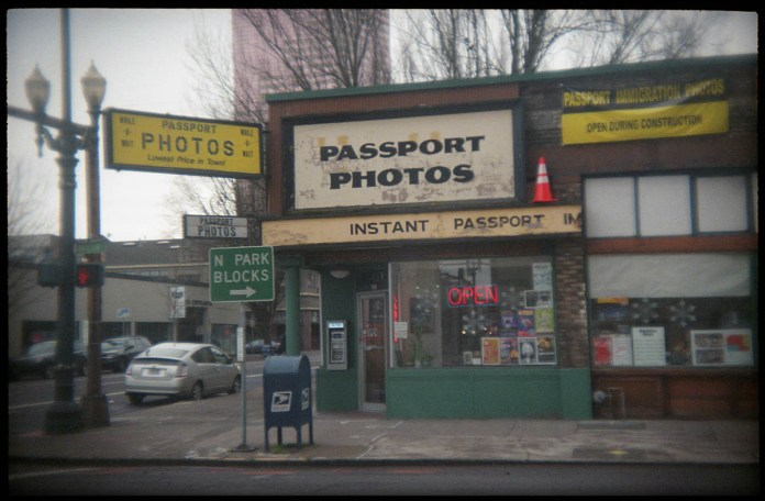 Holga 135BC, Lomography Color Negative 400 film. The old photostore in downtown Portland, Oregon.