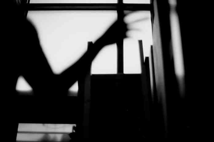 In the shadows - Shot on Efke KB25 at EI 25. Black and white negative film in 35mm format. Nikon FM3A / Nikkor 50mm f/1.2.