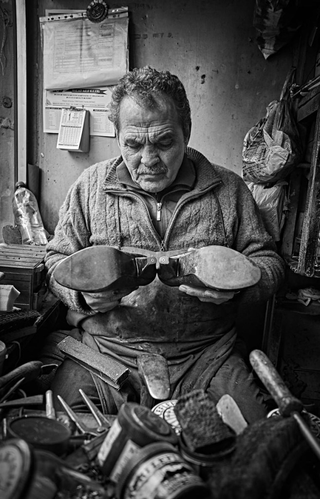 Portrait of a Cobbler working hard in a tiny shop, Istanbul - Keith Moss