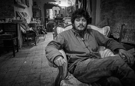 Portrait of a gentle man relaxing in his shop, Istanbul - Keith Moss