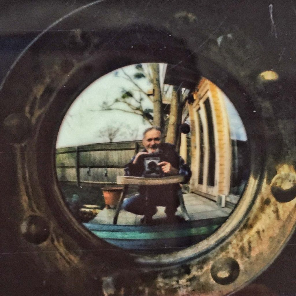 Instax Mini selfie in convex mirror (crop)