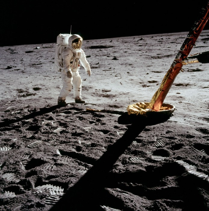 Lunar Excursion Module north-facing strut and footpad (bottom right), with Buzz Aldrin beside. Credit: Neil Armstrong, NASA ID: AS11-40-5902