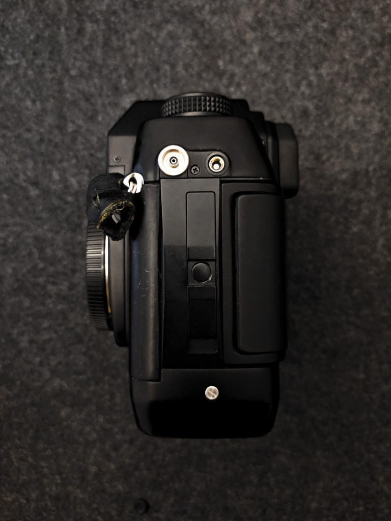 CONTAX AX - Door release, X-Sync port and shutter release cable port