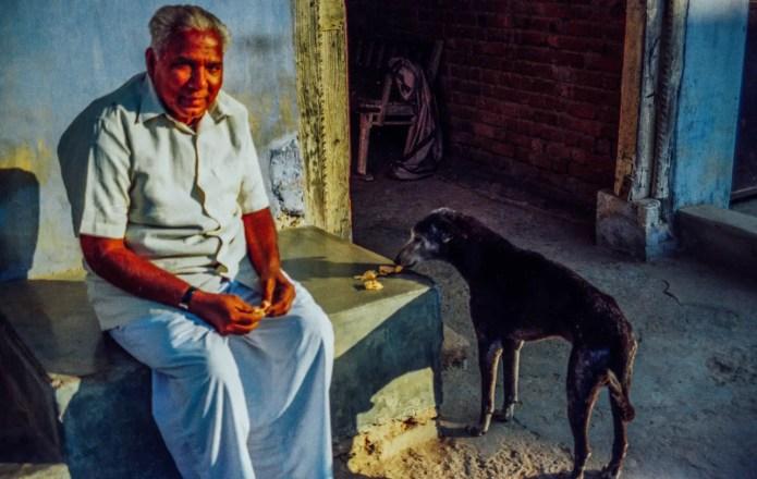 Man and dog. Jesangpura, India. Yashica FX-D