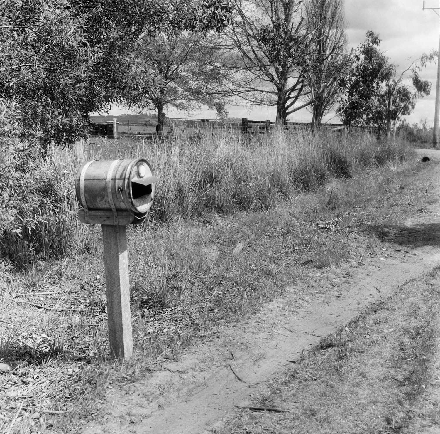 County mailbox, Australian style  Film: Kodak Tri-X Lens: 80mm f/2.8 Exposure:  not recorded  Near Kyneton, Vic, Australia.