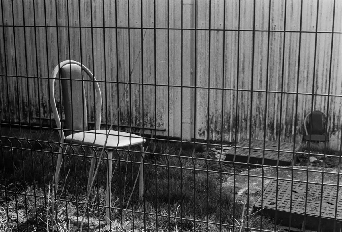 No petting or feeding the chairs - ILFORD HP5 PLUS, Minolta SRT 101b, MD Rokkor 50mm f/1.7 - Nigel Fishwick