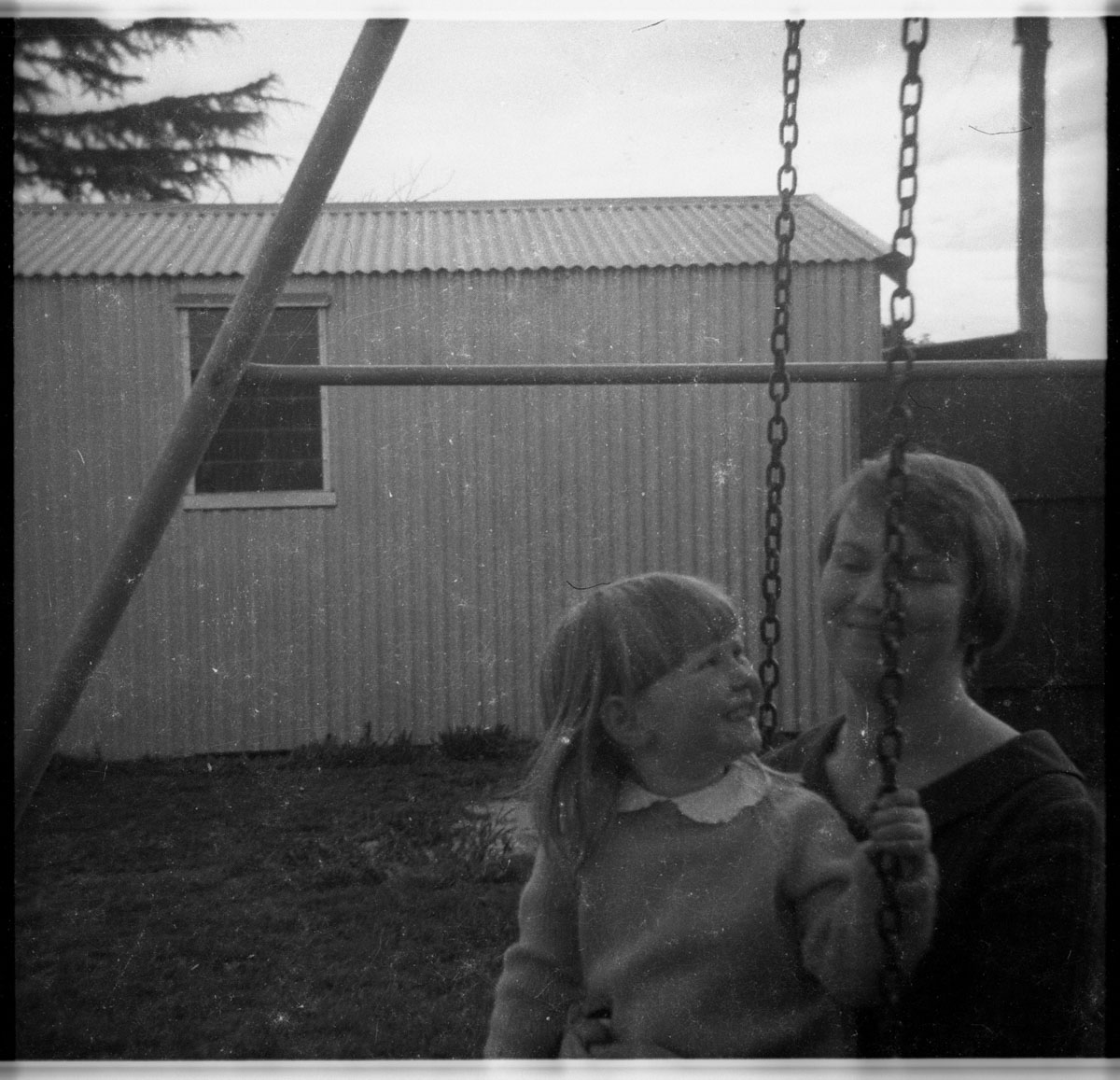 My sister with my mum. Some on the roll were before the wedding, some after. Her fringe is really neat here; maybe it had just been cut so she could be a flower girl.