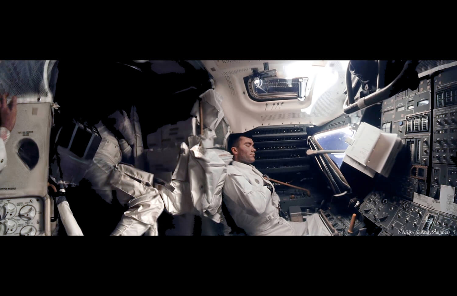 A panorama consisting of over 1,000 image samples. Onboard Apollo 13, Commander Jim Lovell (hand, left) watches over his cold, resting crew inside the Lunar Module, Aquarius, which was used as a lifeboat after the catastrophic failure on the way to the Moon in 1970.