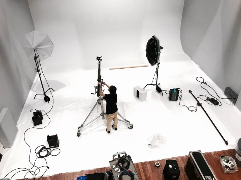 A man sets up a photography studio