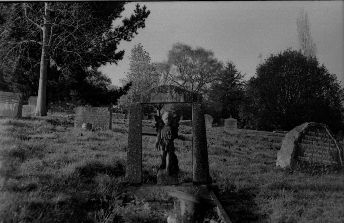Down grave - 5 Frames... From my first roll of ILFORD HP5 PLUS on an old Nikon F-401 (35mm Format / EI 400 / Nikon Nikon AF Zoom-Nikkor 35-70mm f/3.3-4.5) - by Jennifer Hatton-Smooker