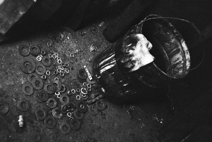 The sorting bucket - Kodak Tri-X 400 shot at EI 400. Black and white negative film in 35mm format.