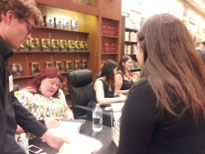 Cassandra Clare signing my books.