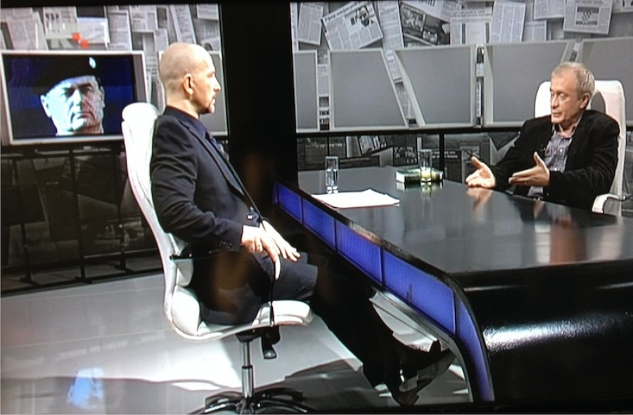 Host Aleksandar Stankovic and his guest Zeljko Peratovic. In the background is a war photos of Josip Perkovic.