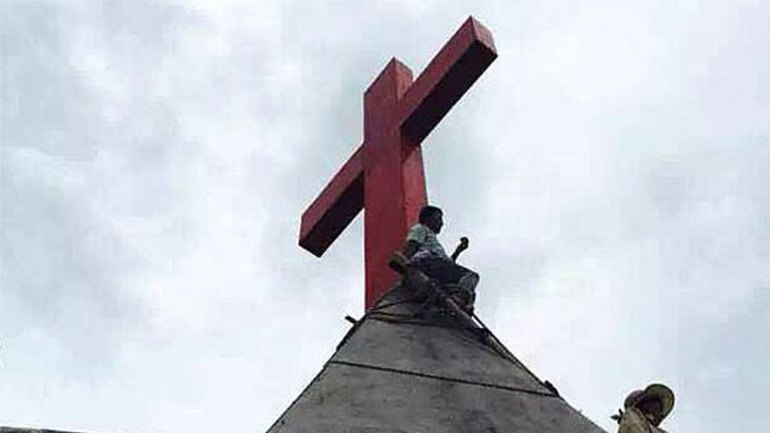 A cross is shown on the roof of a Protestant church in China's Zhejiang province in a file photo. Photo courtesy of a church member