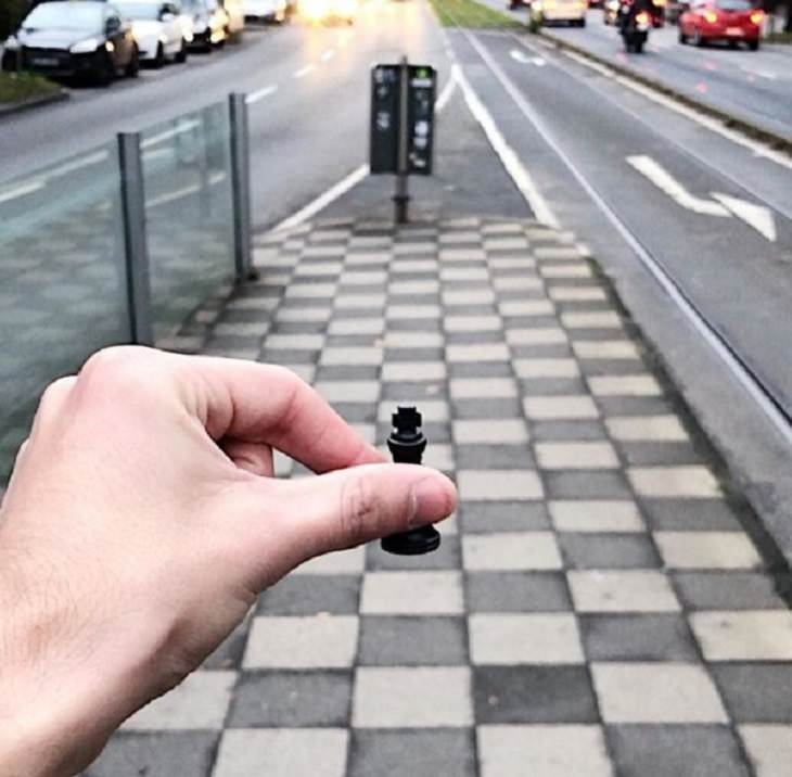 Incredible optical illusions created by Artist and photographer from Portugal Tiago Silva, road resembling chess board with a pawn held on to it