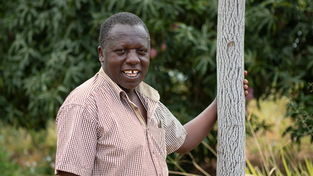Simon Mulli, one of the farmers planting trees for Better Globe on his land. Kenya, July 2018.