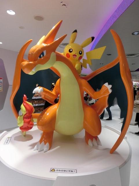 Pikachu riding on Charizard