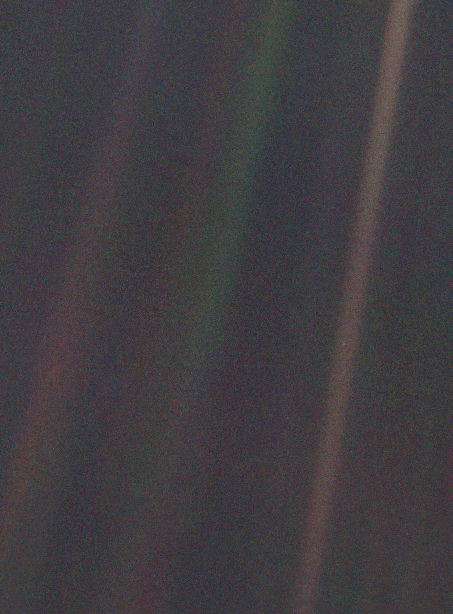 This is the famous image known as Pale Blue Dot.  It's a photograph of Earth taken on February 14, 1990, by the Voyager 1 space probe from a record distance of about 6 billion kilometers (3.7 billion miles).