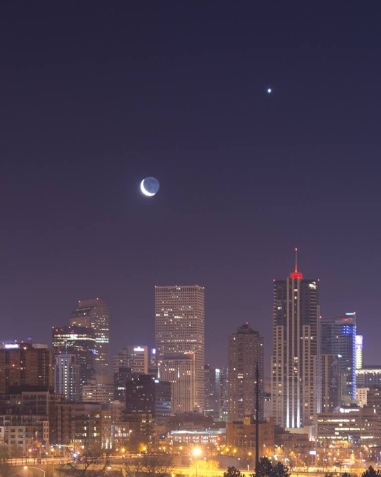 By the time dawn came to the western half of the U.S. this morning (February 26), the moon was below Venus.  Even light pollution couldn't diminish the view of them.  Photo from our friend Christy Sanchez in Denver.  Thanks, Christy.