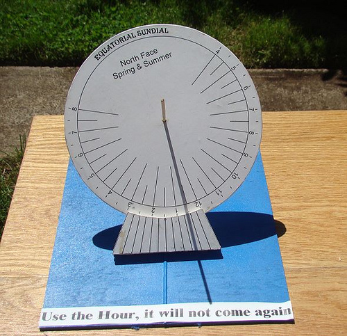 Equatorial sundial by Tom Laidlaw. The north face of an equatorial sundial receives sunshine in spring and summer, and the south face receives it in autumn and winter. On the equinoxes, sunshine should hit neither side of the sundial, but only the edge.