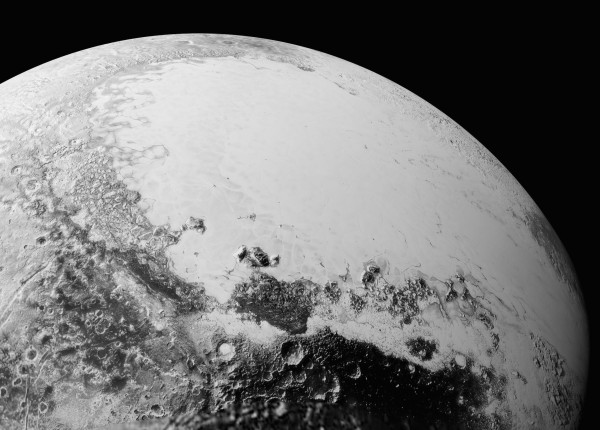 View larger. | Remember the beautiful image of the heart-shaped feature on Pluto? Here it is in closer detail. This image covers an area 1,100 miles (1,800 kilometers) across. Image via NASA/Johns Hopkins University Applied Physics Laboratory/Southwest Research Institute.