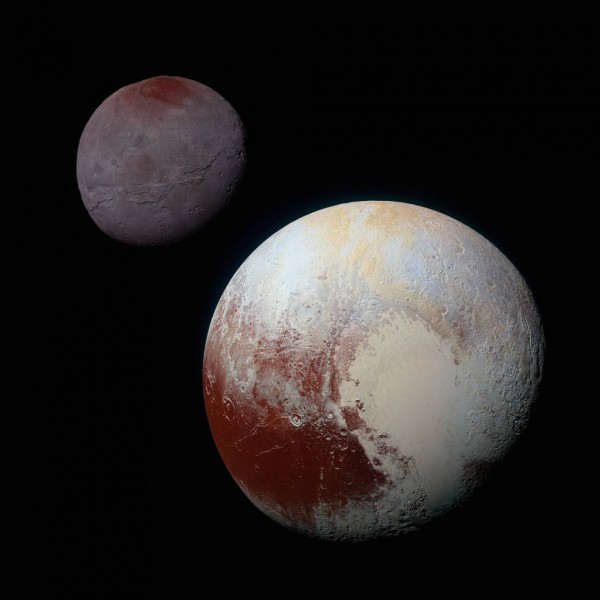 This composite of enhanced color images of Pluto (lower right) and Charon (upper left), was taken by NASA's New Horizons spacecraft as it passed through the Pluto system on July 14, 2015. This image highlights the striking differences between Pluto and Charon. The color and brightness of both Pluto and Charon have been processed identically to allow direct comparison of their surface properties, and to highlight the similarity between Charon's polar red terrain and Pluto's equatorial red terrain. Pluto and Charon are shown with approximately correct relative sizes, but their true separation is not to scale. The image combines blue, red and infrared images taken by the spacecraft's Ralph/Multispectral Visual Imaging Camera (MVIC). Image credit: NASA/JHUAPL/SwRI
