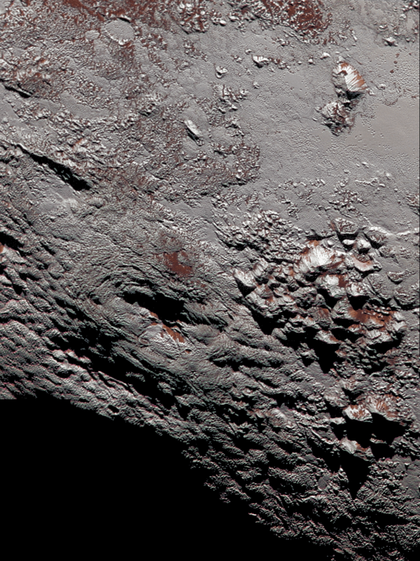View larger.   This composite image of a possible ice volcano on Pluto includes pictures taken by the New Horizons spacecraft's Long Range Reconnaissance Imager (LORRI) on July 14, 2015, from a range of about 30,000 miles (48,000 kilometers), showing features as small as 1,500 feet (450 meters) across. Sprinkled across the LORRI mosaic is enhanced color data from the Ralph/Multispectral Visible Imaging Camera (MVIC), from a range of 21,000 miles (34,000 kilometers) and at a resolution of about 2,100 feet (650 meters) per pixel. The entire scene is 140 miles (230 kilometers) across. Credits: NASA/JHUAPL/SwRI