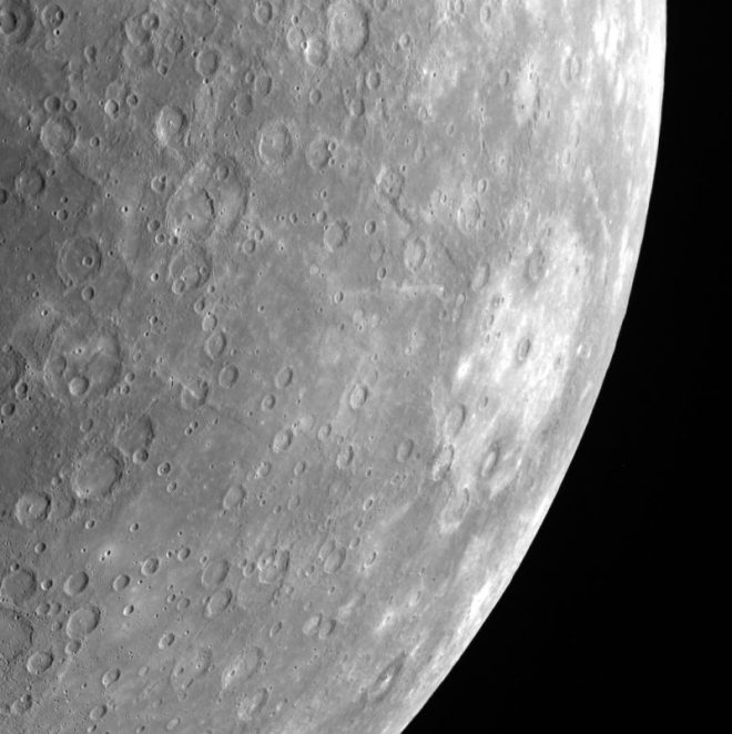 Rembrandt basin can be easily spotted on the right side of this limb image of Mercury. The basin's light crater floor stands out in contrast to the surrounding darker material. Rembrandt is the second largest impact basin on Mercury. You can see Rembrandt basin compared to the size of several U.S. states here. Image via MESSENGER/ Credit: NASA/Johns Hopkins University Applied Physics Laboratory/Carnegie Institution of Washington.