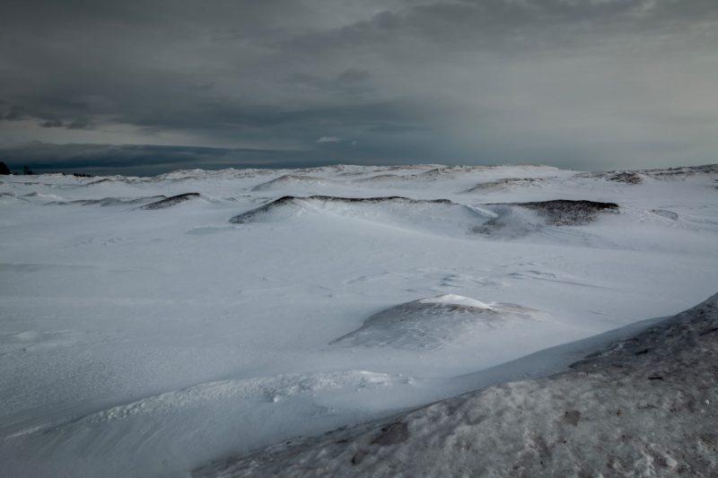 Frozen ground water on lake bank.