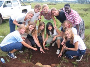 The Go-Team helps plant the first tree