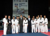 WTF President Chungwon Choue poses with members of the WTF Taekwondo Presentation Team.