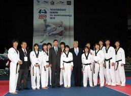WTF President Chungwon Choue poses with members of the WTF Taekwondo Presentation Team.