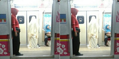 WOMAN CARRIES OUT EARLY MORNING PRAYER IN TRAIN CARRIAGE